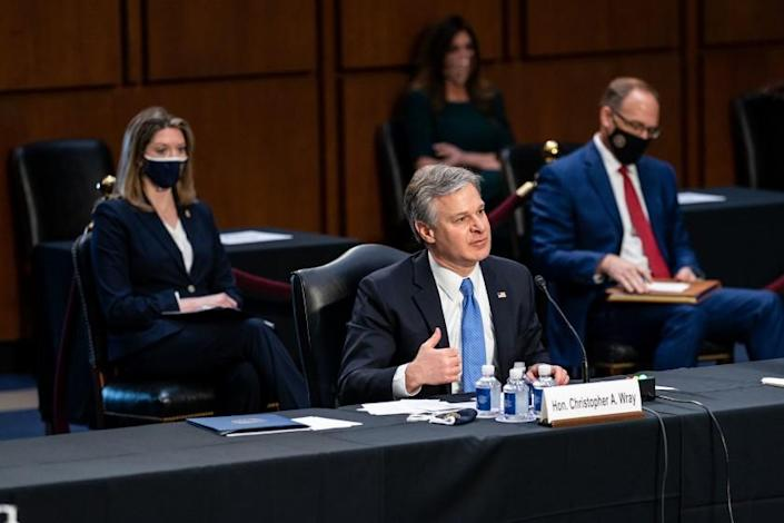 WASHINGTON, DC - MARCH 02: FBI Director Christopher Wray speaks during a Senate Judiciary Committee hearing on Capitol Hill on Tuesday, March 2, 2021 in Washington, DC. In his first public testimony since President Biden took office in January, Director Wray testified to senators that violent extremists motivated by racial anti-governmental ideology have emerged as the biggest domestic terrorism threat. (Kent Nishimura / Los Angeles Times)
