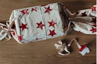 """<p>No gift box in sight? Or maybe your working with a hard-to-wrap item? Stamp a pillowcase, stick your gift inside, and tie the whole thing up with a pretty ribbon. </p><p><a class=""""link rapid-noclick-resp"""" href=""""https://www.amazon.com/Inkadinkado-96680-Star-Wood-stamp/dp/B003A45XEQ?tag=syn-yahoo-20&ascsubtag=%5Bartid%7C10072.g.34015639%5Bsrc%7Cyahoo-us"""" rel=""""nofollow noopener"""" target=""""_blank"""" data-ylk=""""slk:SHOP STAMPS"""">SHOP STAMPS</a></p>"""