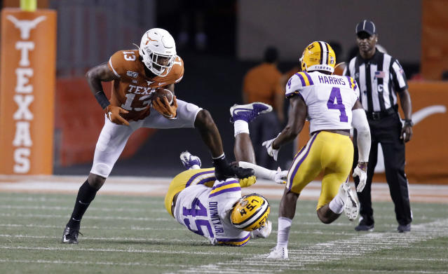 Texas Longhorns wide receiver Brennan Eagles #13 looks for room around LSU Tigers linebacker Michael Divinity Jr. #45 and Todd Harris Jr. #4, Saturday Sept. 7, 2019 at Darrell K Royal-Texas Memorial Stadium in Austin, Tx. LSU won 45-38. ( Photo by Edward A. Ornelas )