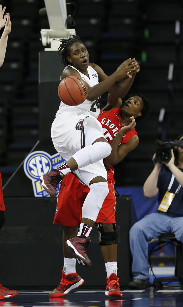 South Carolina forward Aleighsa Welch (24) is fouled by Georgia guard/forward Krista Donald (15) as she goes up for a basket in the first half of a quarterfinal women's Southeastern Conference tournament NCAA college basketball game Friday, March 7, 2014, in Duluth, Ga. (AP Photo/John Bazemore)