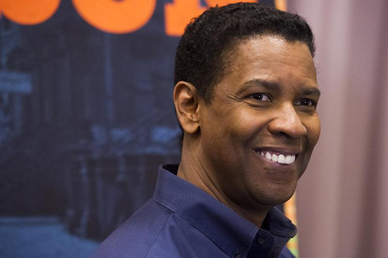 """Denzel Washington appears at a press opportunity for the upcoming Broadway production of """"A Raisin in the Sun"""" on Tuesday, Feb. 18, 2014 in New York. (Photo by Charles Sykes/Invision/AP)"""