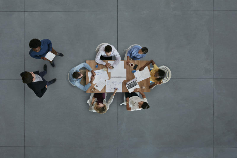 Top view of creative businesspeople having meeting