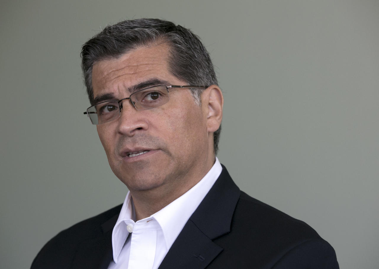 FILE - In this June 9, 2017 file photo, California Attorney General Xavier Becerra is shown during an interview in Sacramento, Calif. Gatorade has agreed not to make disparaging comments about water as part of a $300,000 settlement reached Thursday, Sept. 21, 2017, with California over allegations it misleadingly portrayed waters' benefits in a cellphone game where users refuel Olympic runner Usain Bolt. The dispute between the sports-drink company and California Attorney General Xavier Becerra was settled in less than day after Becerra filed a complaint in Los Angeles County. (AP Photo/Rich Pedroncelli, File)
