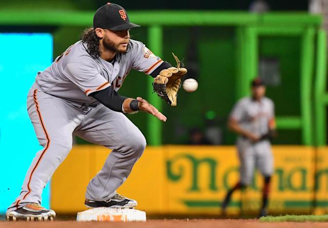 """<a class=""""link rapid-noclick-resp"""" href=""""/mlb/players/8945/"""" data-ylk=""""slk:Brandon Crawford"""">Brandon Crawford</a> unleashed a less-than-accurate throw during batting practice on Thursday. (Getty Images)"""