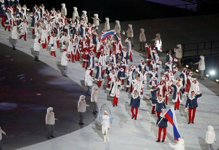 FILE PHOTO: Russia's flag-bearer Alexander Zubkov leads his country's contingent during the opening ceremony of the 2014 Sochi Winter Olympics, February 7, 2014. REUTERS/Issei Kato/File Photo