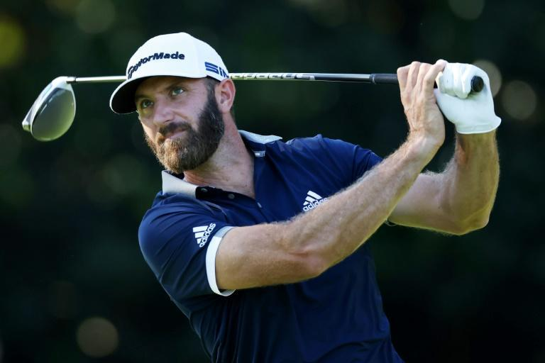 World number one Dustin Johnson closed with a birdie to grab a share of the clubhouse lead Friday in the second round of the 84th Masters
