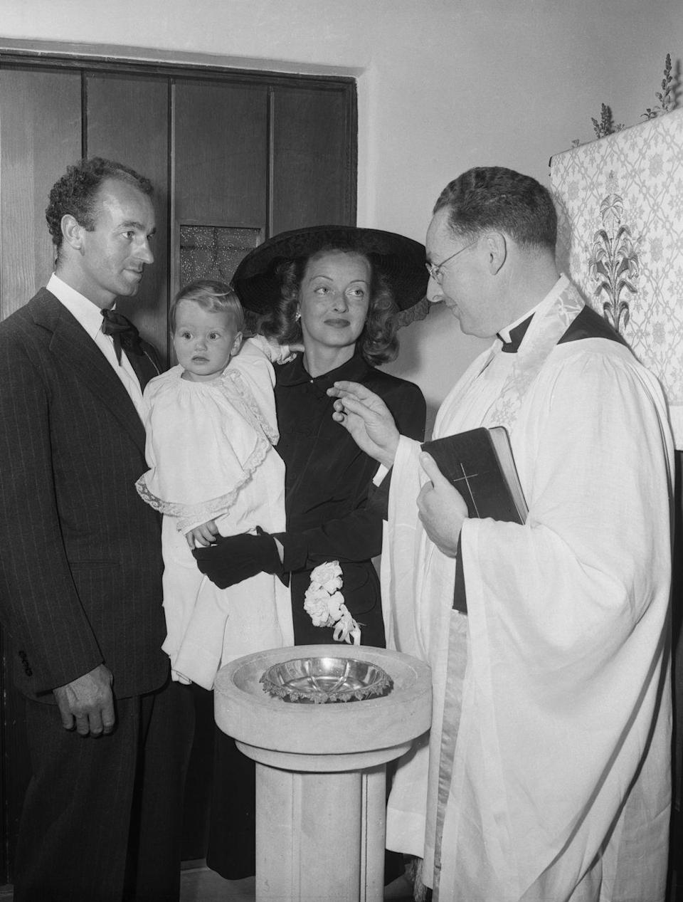 <p>Many Christian churches will hold a christening during services on Easter Sunday for an extra meaningful ritual. Bette Davis and William Grant Sherry baptized their daughter, Barbara Davis Sherry, on Easter 1948.</p>