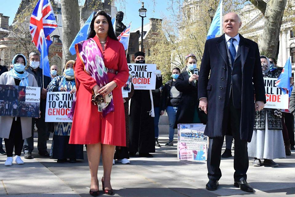 British Conservative Party MPs Nusrat Ghani and Iain Duncan Smith with members of the Uygur community in London on Thursday ahead of the British parliament voted to recognise alleged persecution in Xinjiang as genocide and crimes against humanity. Photo: AFP