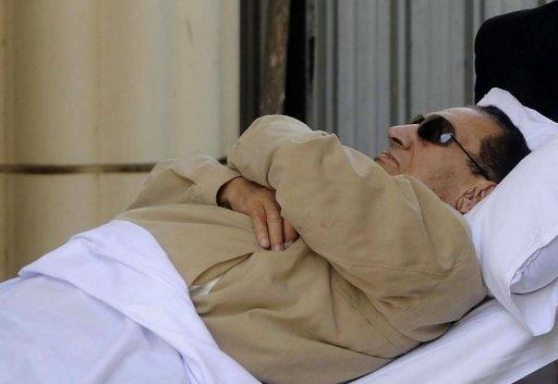 <p>Hosni Mubarak is wheeled into an ambulance on June 2, 2012, following a court hearing. The state prosecutor ordered Mubarak's transfer to hospital on Thursday after his health deteriorated, a prosecution source had said, more than a week after he was briefly hospitalised after slipping in a prison bathroom and hurting his head.</p>