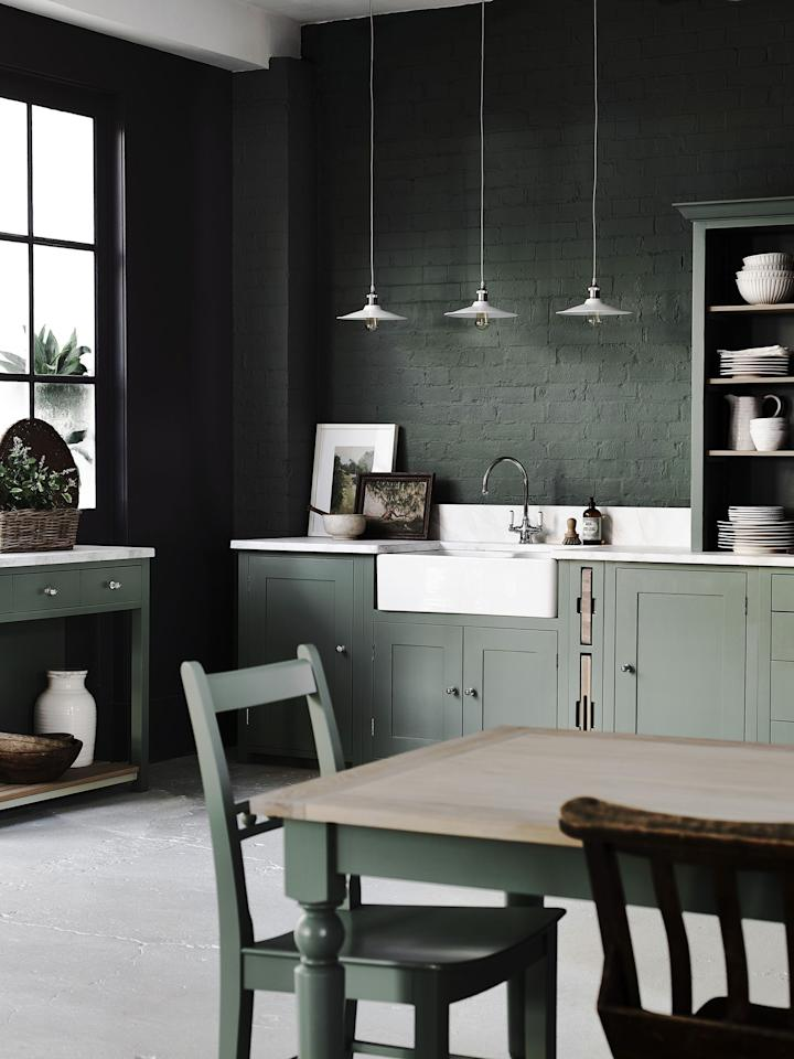 """<p><strong>Whether it's a black, navy blue, <strong>charcoal grey</strong> or forest green <a href=""""https://www.housebeautiful.com/uk/decorate/kitchen/g423/best-kitchen-design-trends/"""">kitchen</a>, darker kitchen colours will help to create a sleek and stylish space that the whole family will love. </strong></p><p>From paint to flooring, kitchen larders and even cabinets, get some inspiration from these dark kitchen design ideas to inspire your decorating choices today. There is something here for everyone to fall in love with. </p>"""