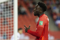 Canada's Alphonso Davies reacts to a missed scoring opportunity during the first half of the team's World Cup soccer qualifying match against Honduras in Toronto on Thursday, Sept. 2, 2021. (Chris Young/The Canadian Press via AP)