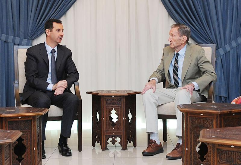 In this photo released by the Syrian official news agency, SANA, Syrian President Bashar Assad, left, meets with former U.S. Attorney General Ramsey Clark, in Damascus, Syria, Wednesday, Sept. 18, 2013. Assad received a U.S. delegation of former members of Congress and anti-war activists including Clark. (AP Photo/SANA)