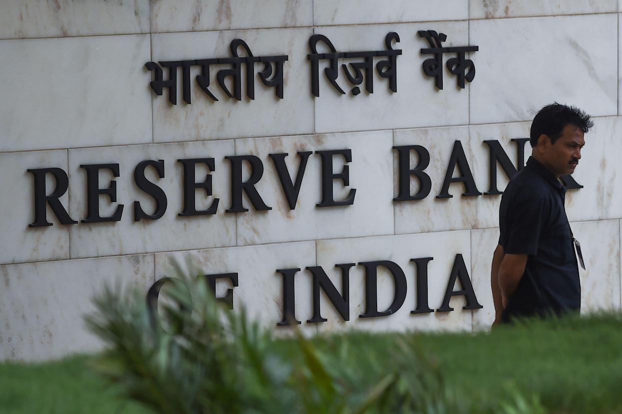 A security staff stands near an entrance of the Reserve Bank of India (RBI) headquarters in Mumbai on August 7, 2019. - India's central bank on August 7 cut interest rates for the fourth time this year, as New Delhi battles sluggish economic growth and high unemployment. (Photo by Indranil MUKHERJEE / AFP) (Photo credit should read INDRANIL MUKHERJEE/AFP/Getty Images)
