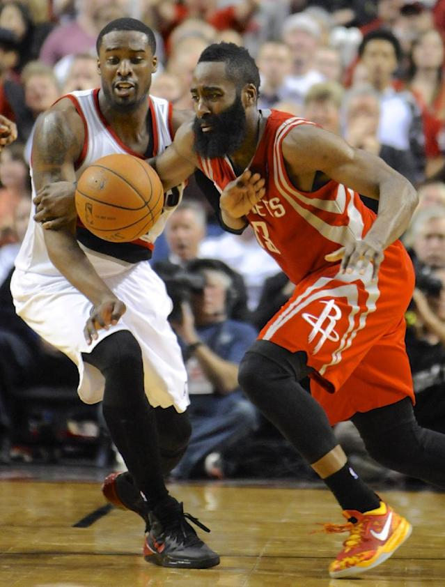 Portland Trail Blazers' Wesley Matthews, left, defends against Houston Rockets' James Harden during the second half of game four of an NBA basketball first-round playoff series game in Portland, Ore., Sunday April 27, 2014. The Trail Blazers beat the Rockets 123-120 in overtime. (AP Photo/Greg Wahl-Stephens)
