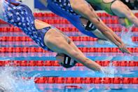 <p>USA's Kathleen Ledecky (bottom) competes in the final of the women's 800m freestyle swimming event during the Tokyo 2020 Olympic Games at the Tokyo Aquatics Centre in Tokyo on July 31, 2021. (Photo by Oli SCARFF / AFP)</p>
