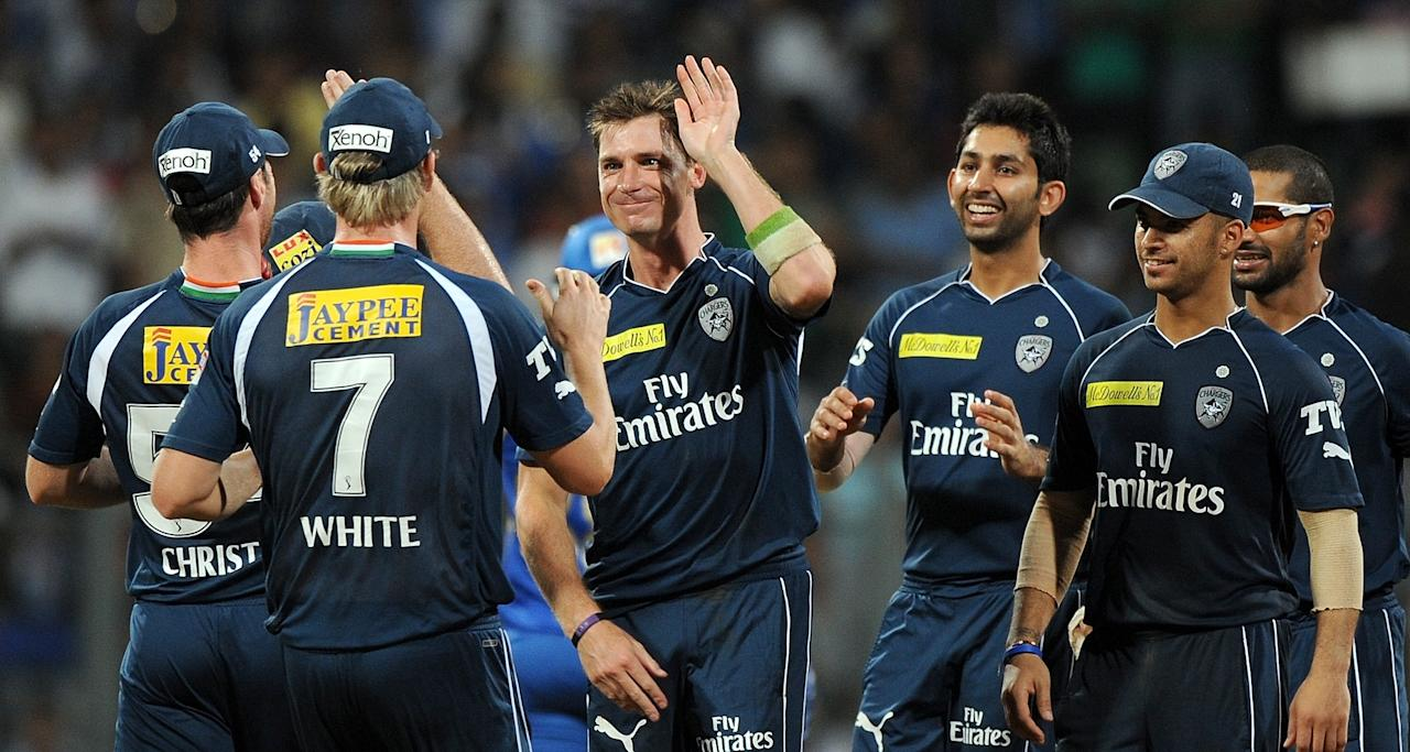 Deccan Chargers bowler Dale steyn (3rd L) celebrates with teammates after taking the wicket of Mumbai Indians batsman Richard Levi during the IPL Twenty20 cricket match between Mumbai Indians and Deccan Chargers at the Wankhede Stadium in Mumbai on April 29, 2012. RESTRICTED TO EDITORIAL USE. MOBILE USE WITHIN NEWS PACKAGE.  AFP PHOTO/Punit PARANJPEPUNIT PARANJPE/AFP/GettyImages