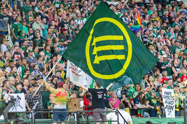 "Several <a class=""link rapid-noclick-resp"" href=""/soccer/teams/portland-timbers/"" data-ylk=""slk:Timbers"">Timbers</a> fans have been suspended by MLS for flying the anti-fascist Iron Front flag. (Photo by Diego Diaz/Icon Sportswire via Getty Images)."