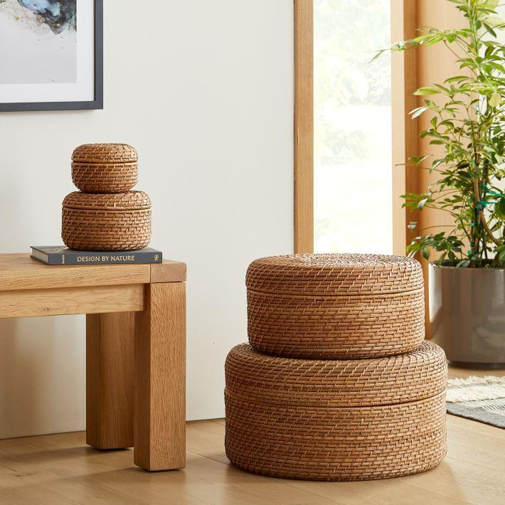 """""""If you're using a common space, like your dining table, as a work space, it's important to have proper storage to put things away once you're done for the day,"""" Cattano tells SELF. She recommends storing items like your laptop, papers, and notebooks in these round woven lidded baskets. Choose one that goes with your decor so it can """"sit out on a shelf or counter within easy reach when the workday starts again."""" $25, West Elm. <a href=""""https://www.westelm.com/products/modern-weave-round-lidded-baskets-d10558/?pkey=cstorage-baskets-bins"""" rel=""""nofollow noopener"""" target=""""_blank"""" data-ylk=""""slk:Get it now!"""" class=""""link rapid-noclick-resp"""">Get it now!</a>"""