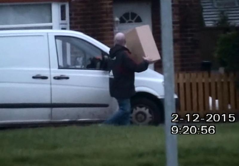 Caught on camera: Paul Carter working as a courier (SWNS)