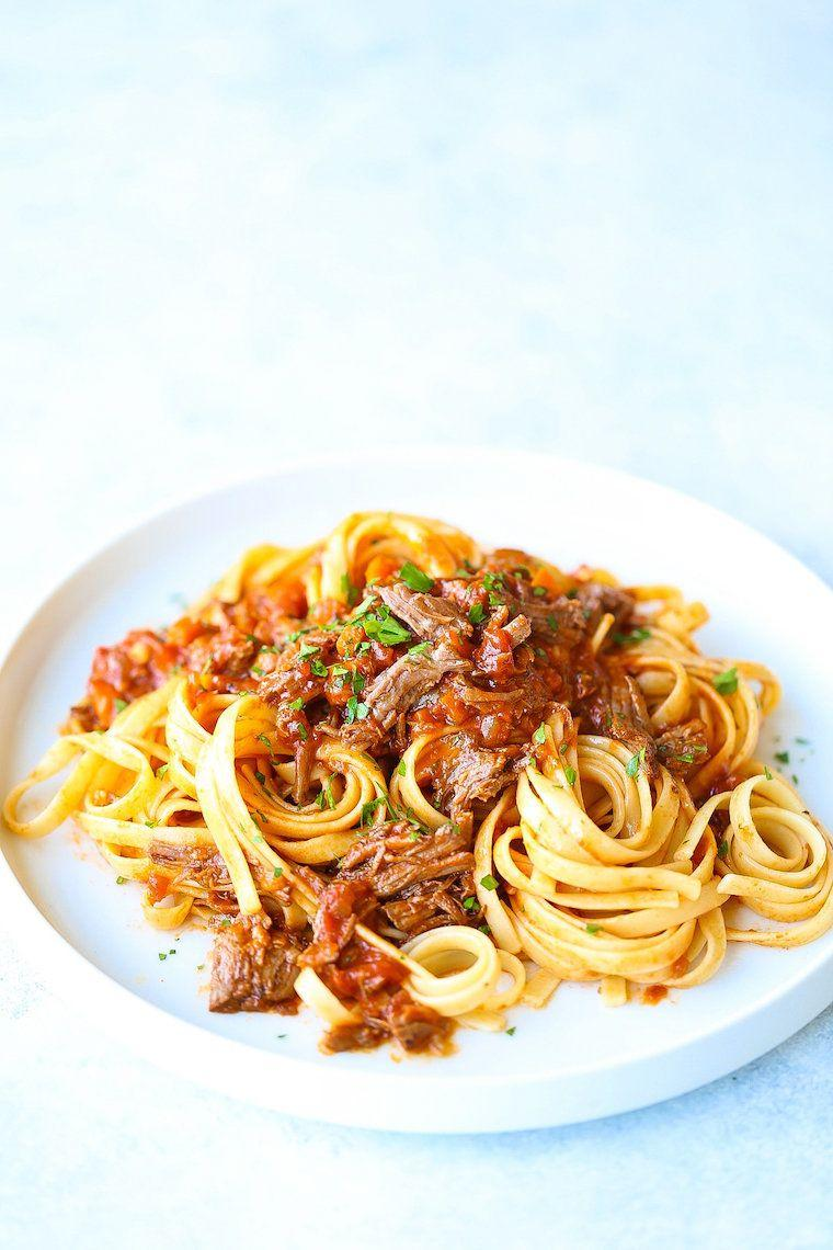 "<strong>Get the <a href=""https://damndelicious.net/2018/08/03/instant-pot-ragu/"" rel=""nofollow noopener"" target=""_blank"" data-ylk=""slk:Instant Pot Ragu"" class=""link rapid-noclick-resp"">Instant Pot Ragu</a> recipe from Damn Delicious.</strong>"