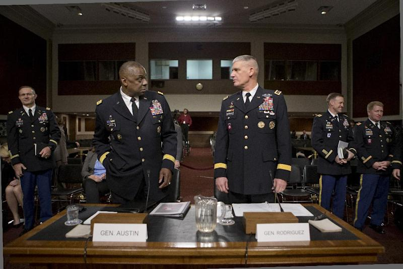 The Senate Armed Services Committee meets on Capitol Hill in Washington, Thursday, Feb. 14, 2013, to consider the nominations of Gen. Lloyd J. Austin III, left, for reappointment to the grade of general and to be commander of the U.S. Central Command, and Gen. David M. Rodriguez, right, for reappointment to the grade of general and to be commander of the U.S. Africa Command. (AP Photo/J. Scott Applewhite)