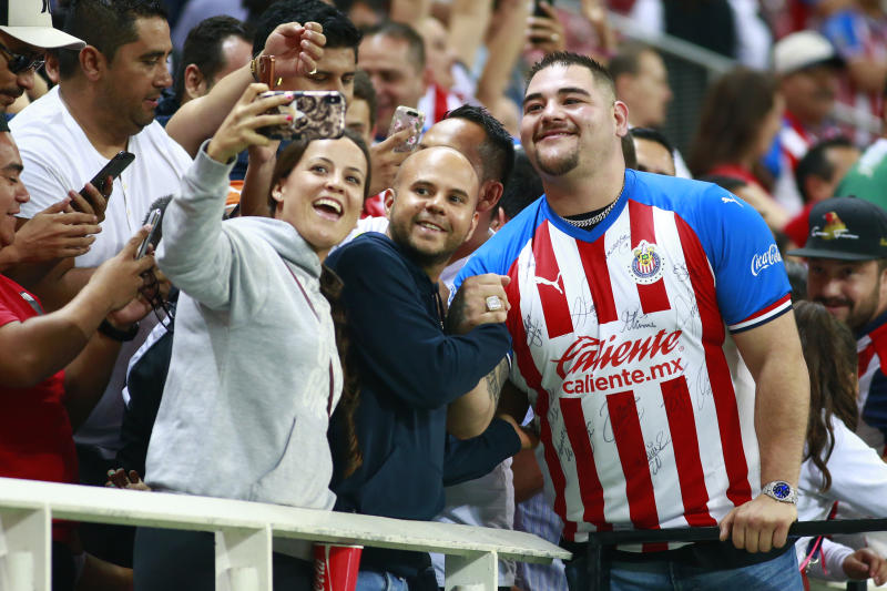 ZAPOPAN, MEXICO - SEPTEMBER 24: Andy Ruiz Jr poses with fans of Chivas during the 11th round match between Chivas and Pachuca as part of the Torneo Apertura 2019 Liga MX at Akron Stadium on September 24, 2019 in Zapopan, Mexico. (Photo by Alfredo Moya/Jam Media/Getty Images)