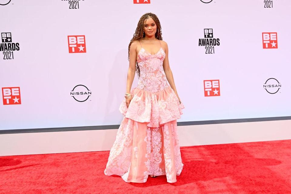 Andra Day attends the BET Awards 2021 in a floor length dress
