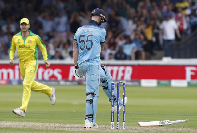 England's Ben Stokes kicks his bat after being clean bowled by Australia's Mitchell Starc, as Australia's Steve Smith looks on during the Cricket World Cup match between England and Australia at Lord's cricket ground in London, Tuesday, June 25, 2019. (AP Photo/Alastair Grant)