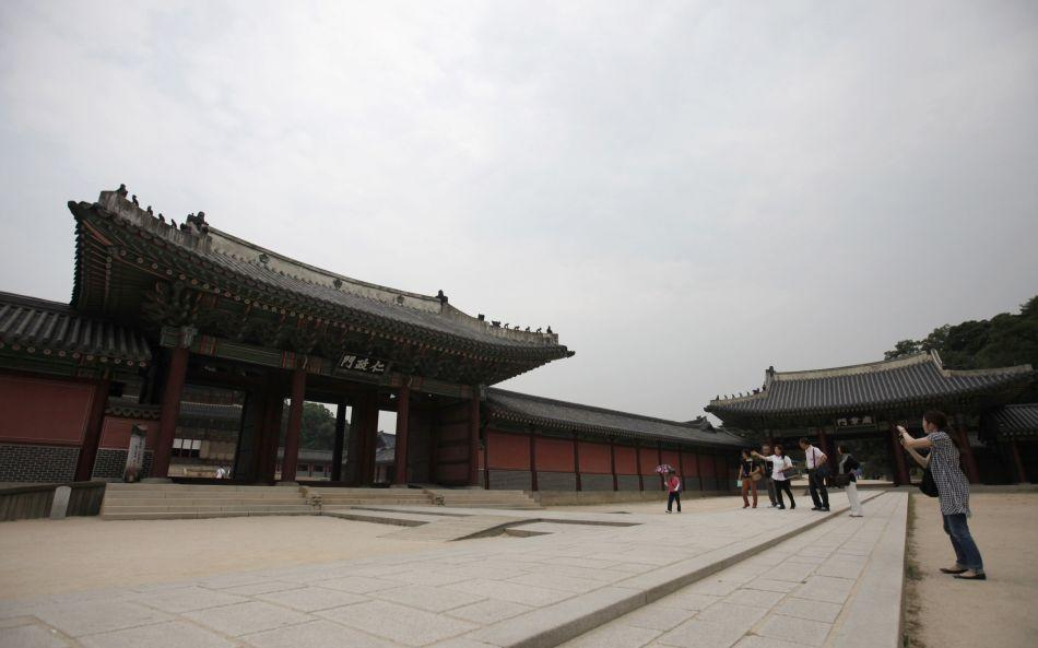 People walk at the Changdeokgung Palace in Seoul.