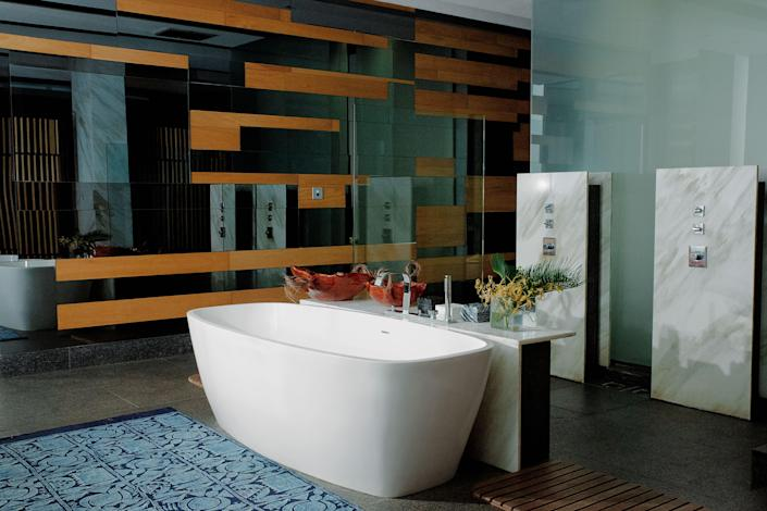 Inside Alára. The bath features a freestanding tub and Zucchetti fittings.