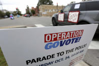 "People participate in a ""Parade to the Polls"" event, organized by Operation Go Vote!, a collaborative of African American civic and social organizations, in New Orleans, Saturday, Oct. 24, 2020. In the best of times, it's a massive logistical challenge to get millions out to vote. In 2020, the difficulty has been dramatically compounded: by fear of the coronavirus, by complications and confusion over mail-in ballots, by palpable anxiety over the bitter divisions in the country. (AP Photo/Rusty Costanza)"
