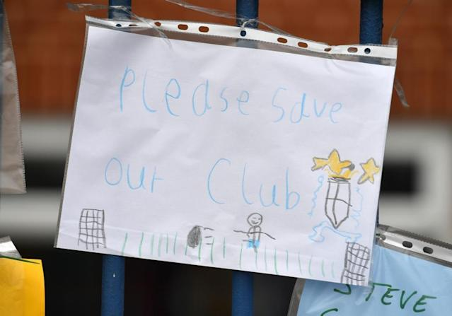 "<span class=""element-image__caption"">A handwritten note on the gates at Gigg Lane.</span> <span class=""element-image__credit"">Photograph: Dave Howarth/PA</span>"
