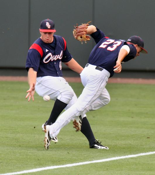 Florida Atlantic's Corey Keller, left, and Brendon Sanger (23) can't handle a single by North Carolina's Landon Lassiter during the first inning at the NCAA college regional baseball tournament in Chapel Hill, N.C., Sunday, June 2, 2013. (AP Photo/Ted Richardson)