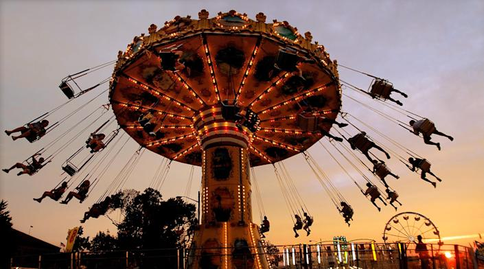 The sun sets as amusement rides and fun continue on opening day of the Illinois State Fair, Friday Aug. 12, 2011 at the Illinois State Fairgrounds in Springfield, Ill. The Illinois State Fair will run Aug. 12-21. (AP Photo/Seth Perlman)