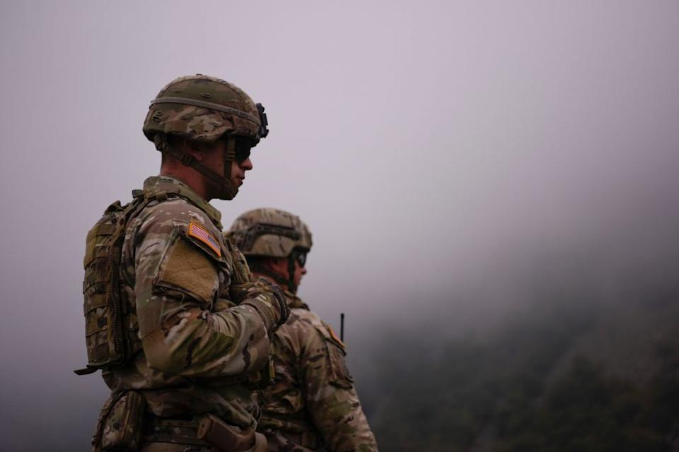 US NATO soldiers patrol near the border between Kosovo and Serbia in Jarinje as Serbs remove trucks and cars that used to block the border with Kosovo.