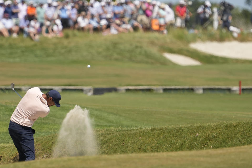 Brooks Koepka makes his second shot on the second hole during the final round at the PGA Championship golf tournament on the Ocean Course, Sunday, May 23, 2021, in Kiawah Island, S.C. (AP Photo/David J. Phillip)