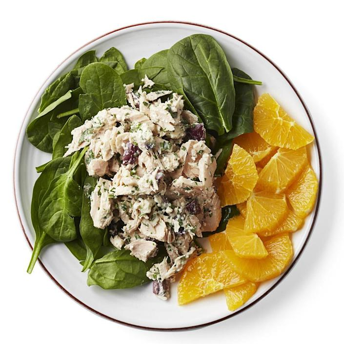 <p>This tuna salad recipe gets an upgrade with olives, feta and a tahini dressing. Served over baby spinach, this is the perfect easy and light lunch or dinner salad.</p>