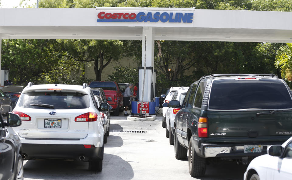 Long lines of cars stretch out into the street as people wait to pump gas at a Costco gas station, Wednesday, Sept. 6, 2017, in North Miami, Fla. Irma roared into the Caribbean with record force early Wednesday, its winds shaking homes and flooding buildings on a chain of small islands along a path toward Puerto Rico, the Dominican Republic, Haiti, Cuba and likely Florida by the weekend. (AP Photo/Wilfredo Lee)