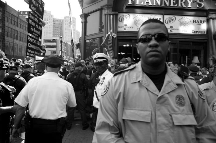 <p>Law enforcement standing by after a fight broke out during a protest outside of the convention. (Photo: Khue Bui for Yahoo News)</p>