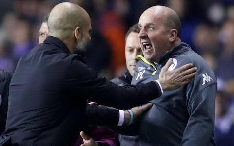 Pep Guardiola and Paul Cook - FA poised for investigation after Sergio Aguero clashes with invading fan after Manchester City's Cup exit at Wigan - Credit: Action Images