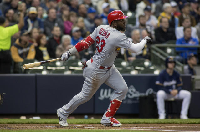 St. Louis Cardinals left fielder Marcell Ozuna hits a home run against the Milwaukee Brewers during the second inning of a baseball game Wednesday, April 17, 2019, in Milwaukee. (AP Photo/Darren Hauck)