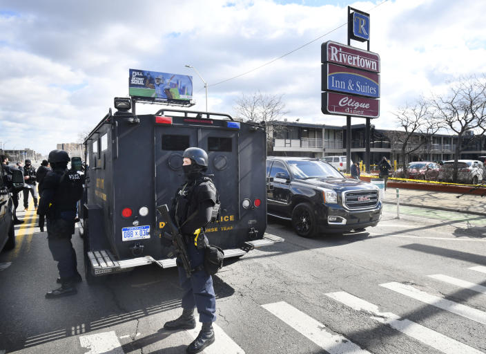 Detroit police monitor the scene of a shooting at the Rivertown Inn and Suites on East Jefferson Avenue in Detroit, Mich., on Monday, March 1, 2021. (Daniel Mears/Detroit News via AP)