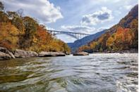 <p>Hawks Nest State Park boasts a beautiful river and bridge in addition to cinematic Autumn colors. </p>
