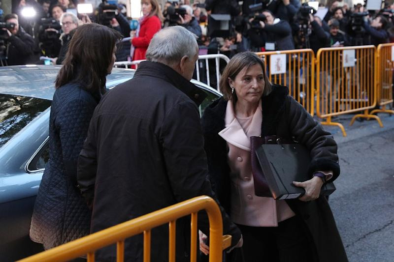 Former speaker of Catalonia's sacked parliament Carme Forcadell (R) arrives at the Supreme Court in Madrid on November 9, 2017 to be questioned over her role in Catalonia's independence drive