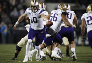 Washington quarterback Jacob Eason turns back to hand off the ball during first half of the team's NCAA college football game against Colorado on Saturday, Nov. 23, 2019, in Boulder, Colo. (AP Photo/David Zalubowski)
