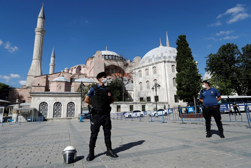 Police officers stand guard in front of the Hagia Sophia or Ayasofya, after a court decision that paves the way for it to be converted from a museum back into a mosque, in Istanbul