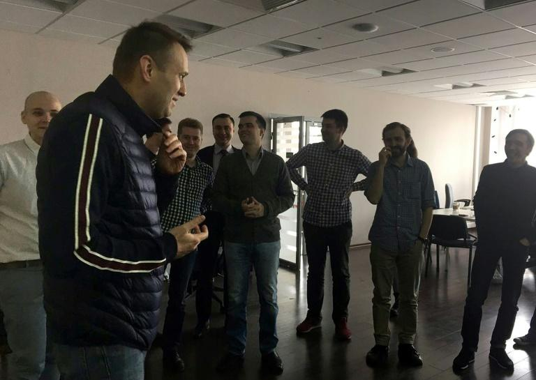 This handout picture obtained on April 10, from Leonid Volkov's Twitter account shows Alexei Navalny speaking with employees at the offices of his anti-corruption foundation in Moscow