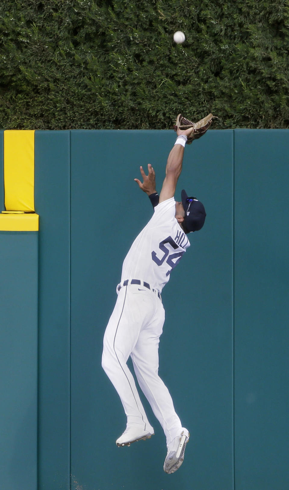 Detroit Tigers center fielder Derek Hill makes a leaping catch of a fly ball hit by Seattle Mariners' Kyle Seager during the first inning of a baseball game Wednesday, June 9, 2021, in Detroit. (AP Photo/Duane Burleson)