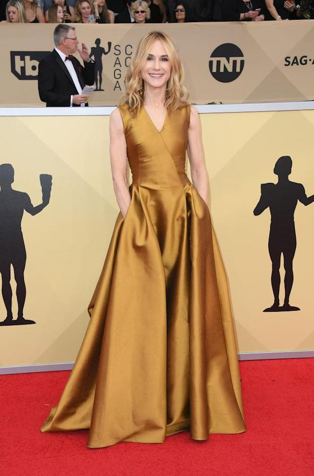 <p>The 59-year-old actress wore a floor-length bronze pleated dress. (Photo: Getty Images) </p>