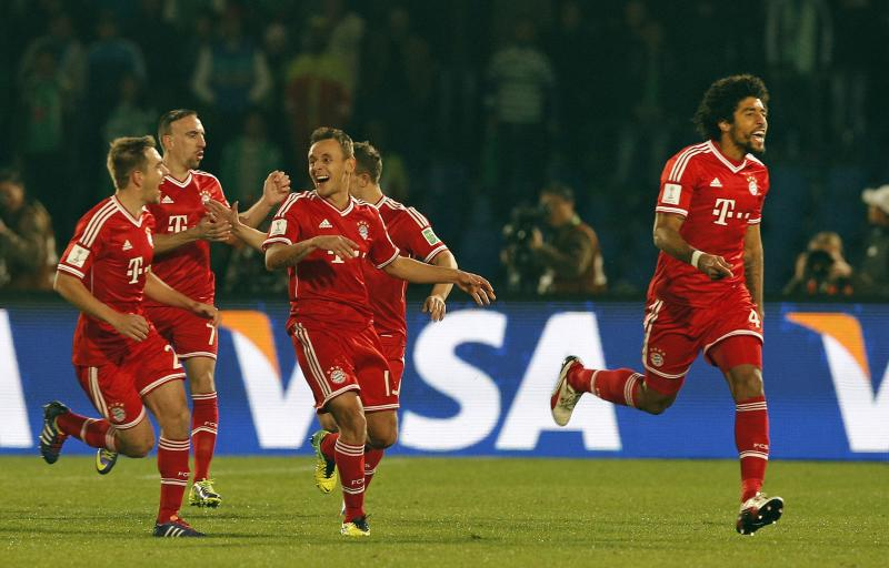 Bayern's Dante, right, celebrates after scoring the opening goal during the final of the soccer Club World Cup between FC Bayern Munich and Raja Casablanca in Marrakech, Morocco, Saturday, Dec. 21, 2013. (AP Photo/Christophe Ena)